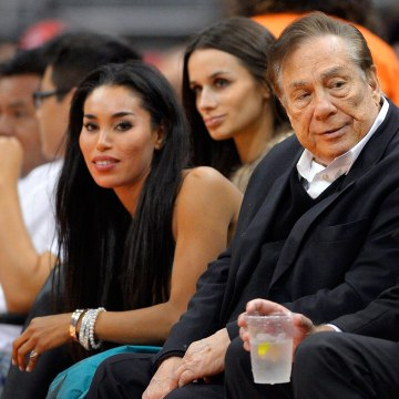 Image: Donald Sterling and V. Stiviano watch the Clippers play the Sacramento Kings