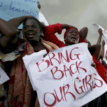 Image: Women react during a protest demanding security forces to search harder for 200 abducted schoolgirls, outside Nigeria's parliament in Abuja
