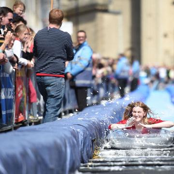 Image: A woman glides down a slide
