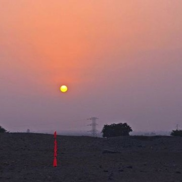 Image: Mono B on the day before solstice (June 20) in 2013. A marker points to the solstice sunset.
