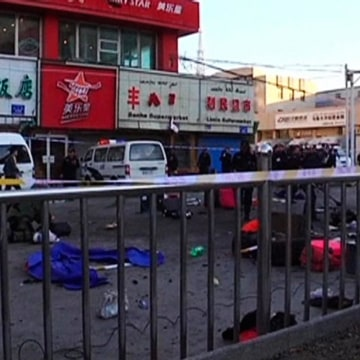 Image: The site of a bomb blast after a bomb and knife attack occurred at South Railway Station, in Urumqi