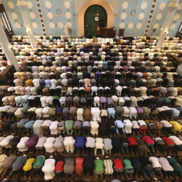 Image: Muslims pray at a Jumat service at the Lagos central mosque