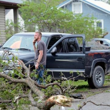 Image: Orrick residents look at the damage after a storm damaged hundreds of homes