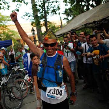 Image: Spanish runner Juan Manuel Cortes celebrates after winning the XVII 101km competition in Ronda
