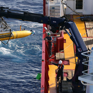 Image: The Bluefin-21 Autonomous Underwater Vehicle is craned over the side of the Australian Defence Vessel Ocean Shield in the southern Indian Ocean during the continuing search for the missing Malaysian Airlines flight MH370