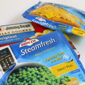 Image:  A package of Hillshire Brands Jimmy Dean sausages is shown with Pinnacle Foods frozen vegetable Bird's Eye brand