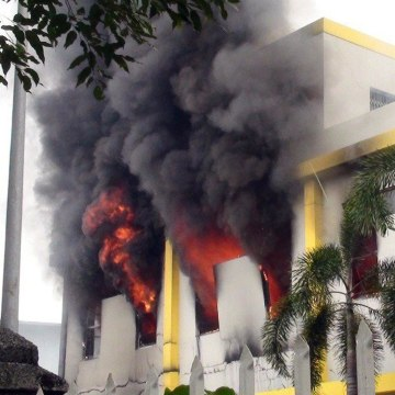 Image: Smoke and flames billow from a factory window in Binh Duong
