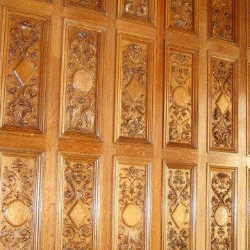 Image: hand-carved wood paneling in the dining room