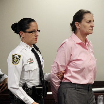 Image: Julie Schenecker is led into Judge Emmett Lamar Battles' courtroom on Thursday for closing arguments.