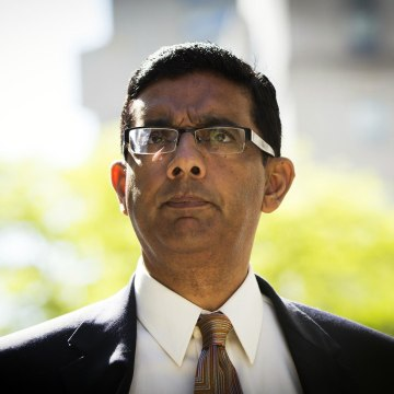 Image: Conservative commentator and best-selling author, Dinesh D'Souza exits the Manhattan Federal Courthouse after pleading guilty in New York