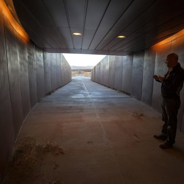 Image: Virgin Galactic's Mark Butler shows off the entrance to the Gateway to Space building where future astronauts will begin their suborbital experience.