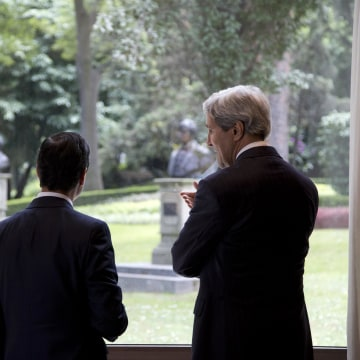 Image: U.S. Secretary of State Kerry and Mexico's President Pena Nieto look out over the grounds from inside Los Pinos presidential residence in Mexico City