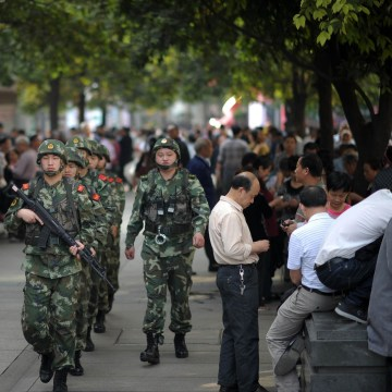 Image: China launched armed police patrols to handle violent incidents