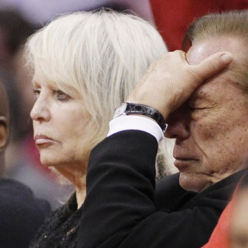 Image: File photo of Los Angeles Clippers owner Sterling putting his hand over his face in the second half of an NBA basketball game in Los Angeles