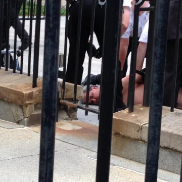 Image: A man stripped naked in front of the White House on Friday afternoon, but was quickly covered up and subdued by officers, according to the Secret Service.
