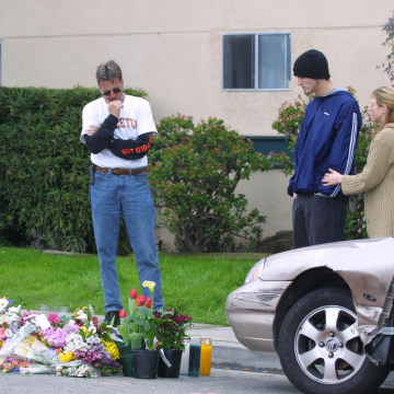 Image: In this Feb. 25, 2011 file photo, Residents of Isla Vista and University of California, Santa Barbara, look at a memorial on the street