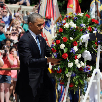 Image: President Barack Obama lays a wreath at the Tomb of the Unknowns at Arlington National Cemetery