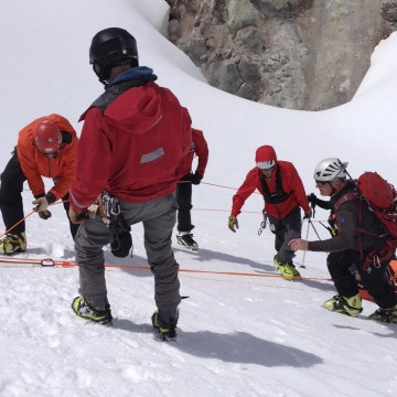 Image: A rescue team tends to rescued hiker James Michael Adams after rescue on Mt. Hood, Oregon