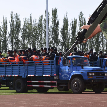 Image: Criminals and suspects are transported to a stadium for a mass sentencing rally in Yili, Xinjiang Uighur Autonomous Region