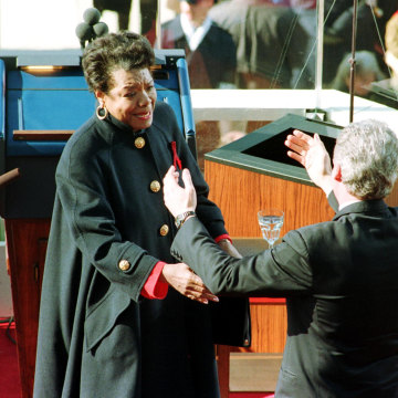 Image: Newly sworn-in U.S. President Bill Clinton reaches out to hug poet Maya Angelou