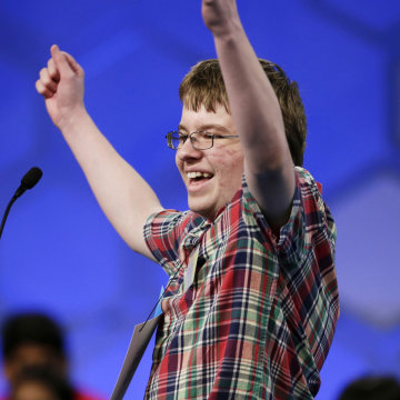 Image: Jacob Williamson celebrates the correct spelling of his word during the semifinals of the 87th annual Scripps National Spelling Bee