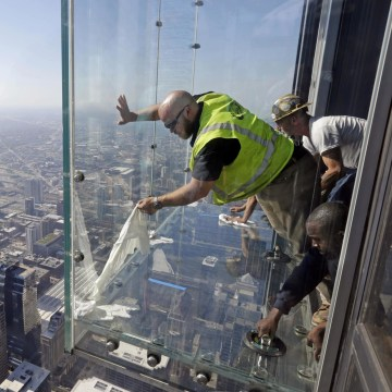 Image: Glazers replace protective coating at Willis Tower ledge