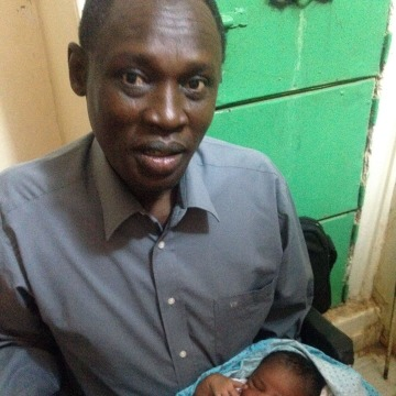 Image: Daniel Wani with newborn daughter Maya