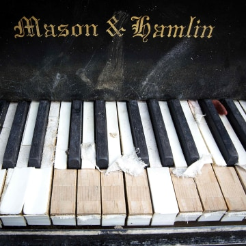 Image: A grand piano that has been left by the East River underneath the Brooklyn Bridge is pictured in the Manhattan borough of New York