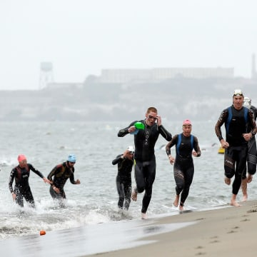 Image: Athletes exit the water during the 2014 Escape from Alcatraz Triathlon