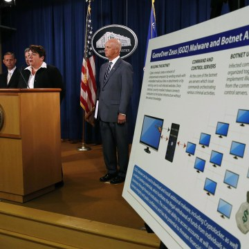 Image: U.S. Assistant Attorney General Caldwell announces criminal charges