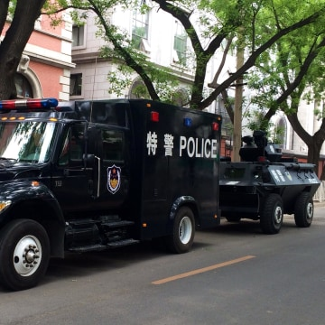 Police vehicles near Tiananmen Square in Beijing on June 4, 2014.