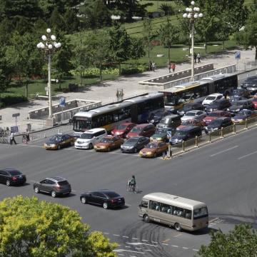 Image: A convoy of cars drive across Beijing's Changan Blvd., near Tiananmen Square