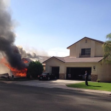 Image: A plane crash set a building on fire in Imperial, Calif., on June 4.