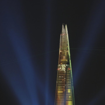Laser beams are seen at the Shard during the laser and searchlight show which marks the completion of the exterior of the Shard building in central London