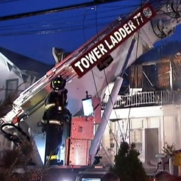 Image: A five-alarm fire at a duplex on Staten Island, New York, early Thursday.