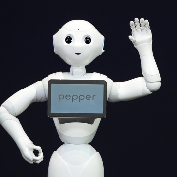 Image: Humanoid robot 'Pepper', equipped with an emotion engine, 'speaks' during a press conference