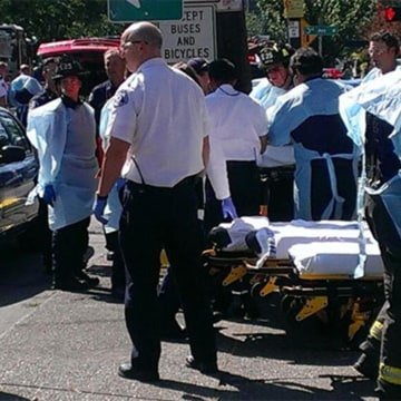 Image: First responders work at Seattle Pacific University after a shooting.