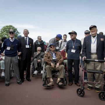 Image: U.S veterans arrived at the U.S. cemetery in Collville, Normandy on Thursday.