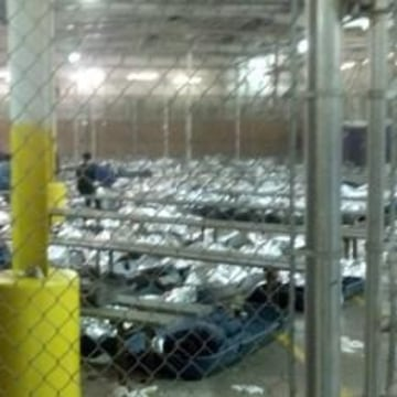 Image: Children resting under foil blankets at a Border Patrol facility in Nogales, Ariz.