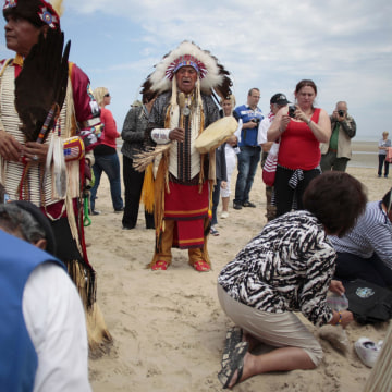 Image: Descendants of Comanche indian soldiers pray on Utah Beach