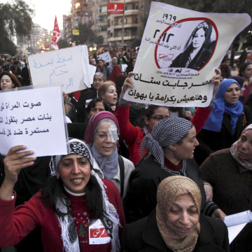 Image: Women shout solgan against Egyptian President Mursi and members of Brotherhood's during march and a protest against sexual harassment and violence against women in Cairo
