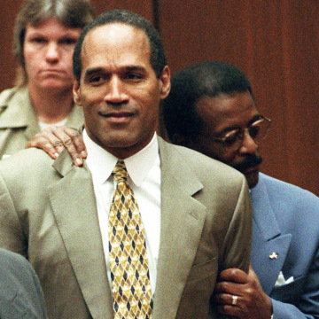 Attorney Johnnie Cochran Jr. holds onto O.J. Simpson