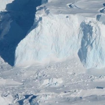 The edge of the Thwaites glacier, shown here in an image taken during Operation Icebridge, a NASA-led study of Antarctic and Greenland glaciers. The blue along the glacier front is dense,