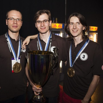 Image: Wojciech Jaskowski, Tomasz Zurkowski and Piotr Zurkowski from the Polish Team Need for C, pose with the trophy after winning the coding world finals