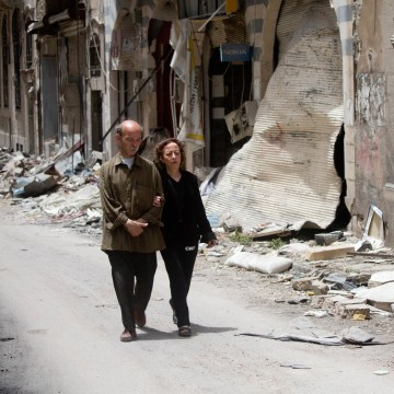 Image: Zeinat Akhras and her brother Ayman walk to from home to a church in Homs