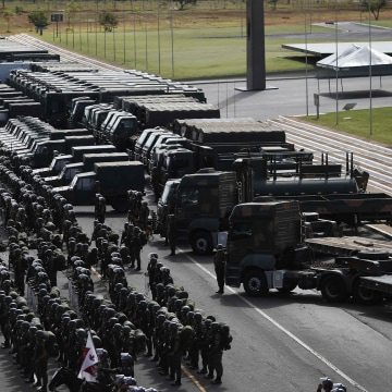 Image: Members of Brazilian Army, Navy and Air Force attend presentation of Defence and Security personnel and equipment that will be used during the 2014 World Cup in Brasilia