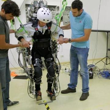 "Image: Brazilian neuroscientist Miguel Nicolelis works on the ""Walk Again"" project"