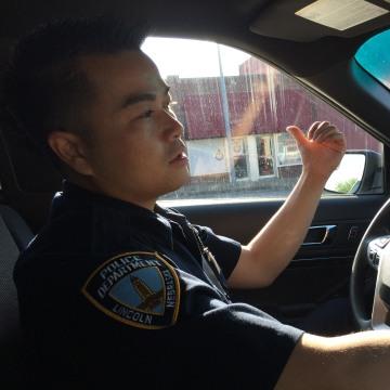 Officer Tu Tran on patrol in Lincoln, Nebraska.