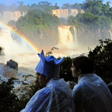 Image: Tourists enjoy Iguacu Falls on June 12, 2014, in Foz do Iguacu, Brazil.