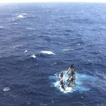 Image: The HMS Bounty sinks in the Atlantic Ocean during Hurricane Sandy southeast of Hatteras